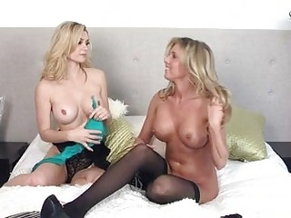 2 gorgeous blondes stripping and fingering on bed