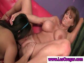 Two busty lesbians get together with cougar Darla Crane eating pussy