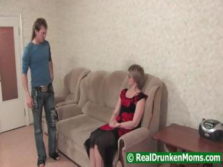 Drunk mom with a younger boy starts to fuck and then passes out