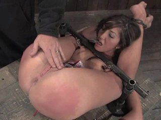 The slut was tied down as her pussy was poked with fingers and toys