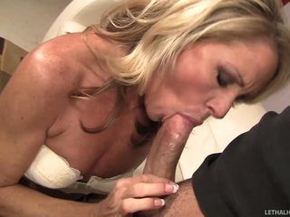 Good looking slim golden-haired MILF Nikki Charm takes sturdy rod in her mouth. But after rod sucking she uses her tongue to give pleasure to her fuck buddy. She licks his asshole and this chab loves it so much.
