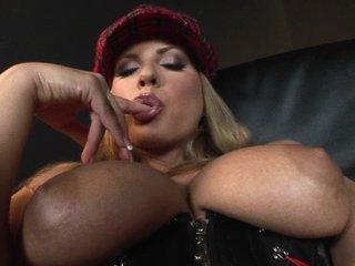 Breasty corset wearing Dorothy Black in solo masturbation action