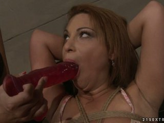Many Bright forcing a hot babe to suck a dildo