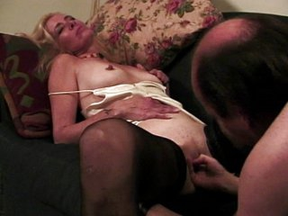 Mature blond fucking gigolo on her couch