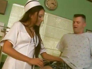 Sexy nurse Alexis Love checks her patient's reflexes