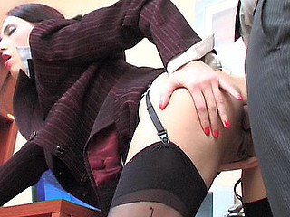 Lewd secretary in strict office suite and nylons opening up her wazoo cheeks
