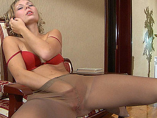 Heated cutie strips to her silky hose and rubs her pink talking on the phone