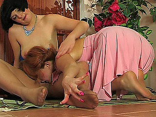 Steamy lesbo sweethearts in silky tights tongue-polishing nylon feet on floor
