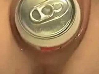 Unruly wanton dame pushes beer can inside her wide vagina. It makes her feel some kind of pleasurable pain and she moans aloud as it disappears inside her pussy.