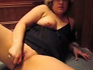 Chubby mature slut in nightwear massages her horny pussy with her hand taking penetrative dildo in it.