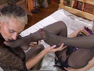 Sapphic blondes take up with the tongue and sniff their nyloned feet previous to using a dong