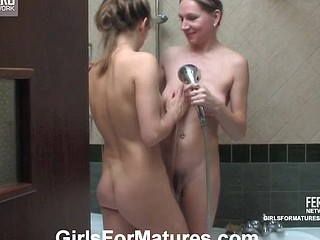 Freaky mamma and curvaceous honey rubbing against each other taking sexy shower