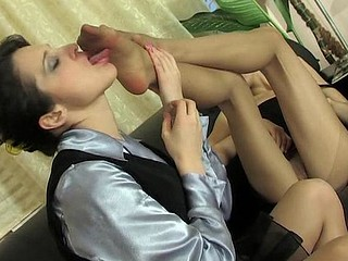 Sizzling sexy lesbo chicks licking their tasty pantyhosed feet by turn