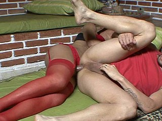Sultry dick-beauty in raunchy red nylons tempts a guy into opening his arse