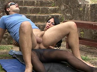 Drop dead gorgeous shemale in sheer black hose screwing an desirous guy