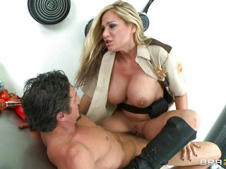 Tyler Faith is a sexy sheriff deputy with what looks like a pair of .45's, and a gun. Right now she's riding down her man on a prep table. Instead of getting lunch, she's having a cock break. She rides him both ways, with a masturbation break in between.