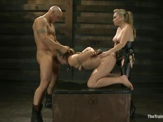 Chastity Lynn is a submissive girl eager to fulfill her dark sexual desires. Aiden Starr and her friend Derrick Pierce are there to give her what she needs. The older hot babe with a strapon goes on and fucks her shaved pussy, while the white guy bashes her throat roughly. They have a great time together.