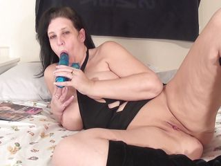 Leni a fucking sexy bitch. This brunette mature has nice boobs and cherry like nipples on them. She is taking a huge dildo to satisfy her hunger. At first she is sucking that dildo and then she is inserting it in her pussy. Next she is fingering her pussy and feeling her juice with her hands. Then she is licking her juice.
