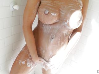 What do we have here? A smoking hot milf with long brown hair and a very sexy body. She is under the shower and cleans herself with a lot of soap, paying special attention to her ass and cunt. After she is all soapy washes the soap and dries before getting into bed. Now that she's clean, will she get dirty again?