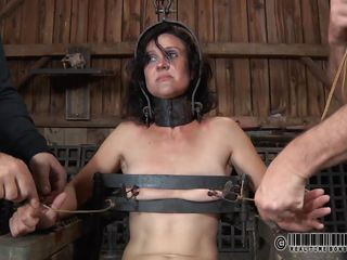 Something interesting is going on in this barn and James is in the middle of attention. They've tied her on that chair, used metal clamps to gape her pussy and now everyone wants to humiliate and play with her. The small tits brunette likes her position and we like to see her that way