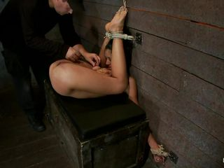 It all starts with a good old fashion spank on the ass then the executor progresses and applies a vibrator on her cunt making her moan with lust, she has suckers on those hard nipples and her tits are tied so hard that the rope squeezes them. Her body is flexible, watch her in that weird position that allows full access to her cunt and anus, makes you wonder if she will get those holes filled doesn't it?
