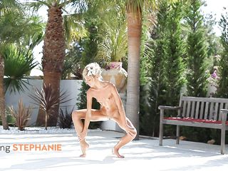 Can you believe how sexy and flexible this blonde chick is? She has her moves and practices a lot, keeping herself in form. Look how skinny and hot she is, exercising outside naked and spreading her legs with that shaved tight cunt between them. We wonder how she handles in bed, she does the same moves there too?