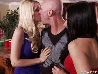 Two gorgeous sluts one blonde and one brunette with big beautiful breasts desire a threesome with Johnny Sins. They all start kissing and touching themselves. He starts licking the blonde chick's boobs while the brunette is taking off his belt, wanting to take off his pants.