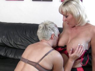 Two sexy mature blondes are horny and ready to have intense sex. One of them licks the other ones breasts and sucks her nipples before getting down on her shaved vagina while she rubs her pussy. Now one of the sluts takes a sexual toy, a dildo more exactly and the other one prepare herself for a deep penetration, spreading her legs and offering her hot shaved cunt.