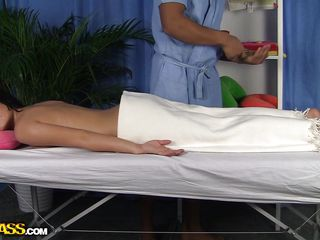 Danna has a beautiful body and now she's all oiled up and ready for her massage. She's relaxing under those firm hands and slowly gets horny. The masseur rubs her butt and can't help himself not to finger her. Look how his fingers slide inside her oiled anus, maybe he will slide something else in there?