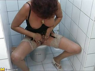 The action takes place is a public restroom where a short hair mature woman with a small pair of tits starts rubbing herself in all kind of positions. Although she pass her youth for a time, her shaved pussy is in a great shape and it's getting wetter with every finger she feels