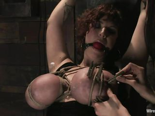 Mariah Cherry is tied up to a beam and gagged. Princess Donna Dolore has already put clothespins on Mariah's hairy snatch and puts more on her huge tits. She puts a vibrator to the thick-legged slut's cunt, making her wet. Mariah asks for and is granted permission to cum and she does very loudly.