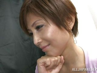 She's a normal lady but acts naughty at the sight of hard cocks. The mature Japanese woman it's a bit shy and thinks what to do, to suck those cock or not to do it. Well she decided to have a taste and now she's about to get a bit more then she thought. She's in a good shape too, want to see her in action?