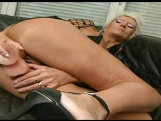 Horny Gilf Claudia masturbates by inserting a big dildo in her old but still hot vagina. This old blonde slut loves a good fuck and when this guy here sees how she fucks herself he gives her a helping hand, fingering her ass and then inserting the sex toy in her anus. Because she enjoyed his help, she gets down on her knees like a good granny and gives a hot experienced blowjob.