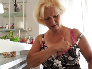 Janice is all alone today and obviously very horny. She begins squeezing her big tits while who knows what thoughts go through her head. Soon the clothes start coming off, revealing a pink bra and matching panties. Soon Janice has to lay down and start rubbing her pussy and licking her nipples.