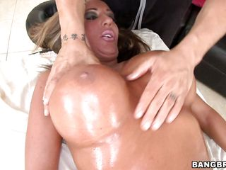 She has a huge pair of knockers and she is lying on that massage table in her birthday suit looking all ready to fuck and masseuse took full advantage of it. He rubs oil in her body and then rubs her tongue in her cunt. She gets so excited that she gives him blowjob and gets anally fucked by baldy