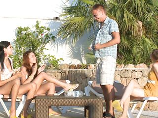 Things are getting hot and naughty at that table when the girls are starting to undress. Revealing their sexy bodies makes the guy's dick hard so the brown haired one gives it a mean suck and lick with the brunette one at her back. See how lustful she sucks that penis, will the brunette get in her place soon?