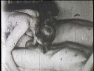 This film is so old it's in black and white. Two dudes laying in bed get their cocks sucked hard by two beautiful girls. They lay side by side and the two chicks happily suck away at their massive cocks.