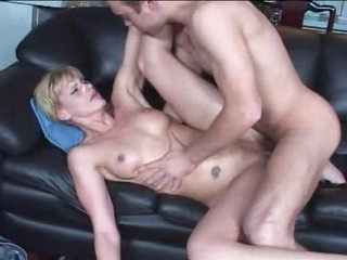 Milf with tattoos rides his big boner