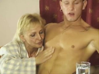 Mature blonde pounded on her dining room table
