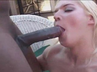 Shaved girl gets a black dick up her butt