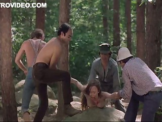 Four Horny Lumberjacks Humiliate Camille Keaton Outdoors In The Forest